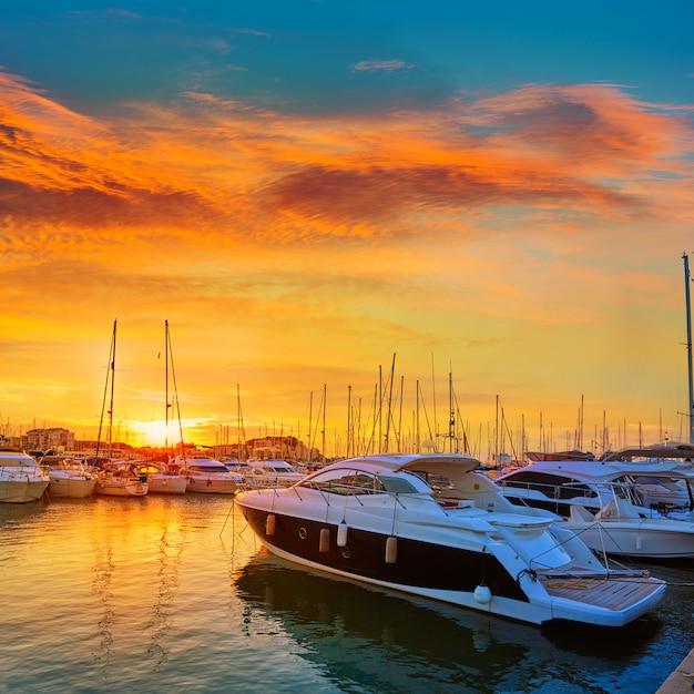 Denia sunset in marina boats mediterranean spain Premium Photo