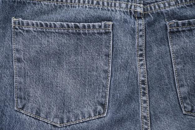 Denim textured fabric with a trendy design seam. selective focus. classic jeans background. Premium Photo