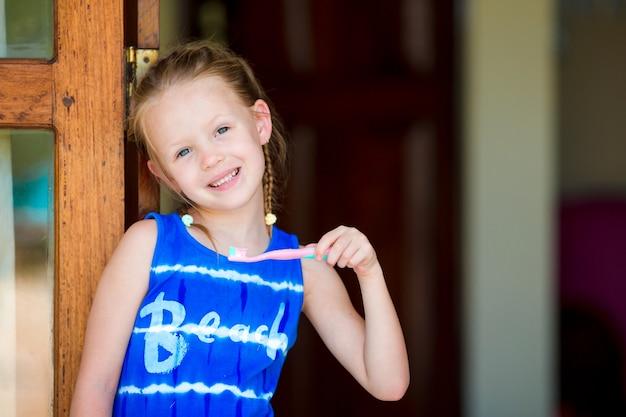Dental hygiene. adorable little smile girl brushing her teeth Premium Photo