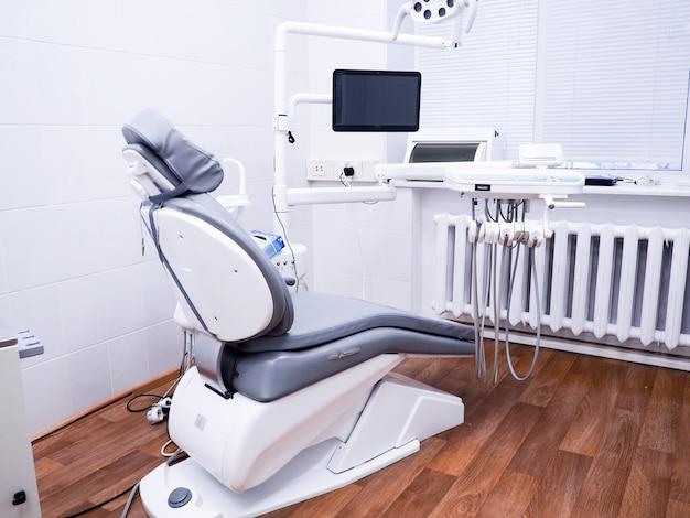 Dental office, patient's chair, tools for dentist, dental hygiene. Premium Photo