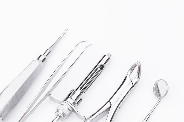 Dental tools and equipment on white background Free Photo