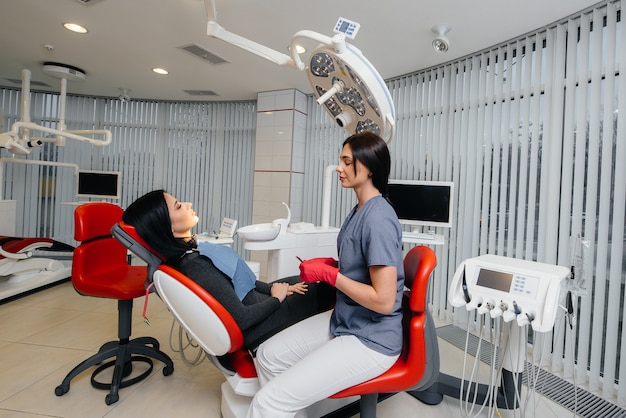 The dentist conducts an examination and consultation of the patient. dentistry. Premium Photo