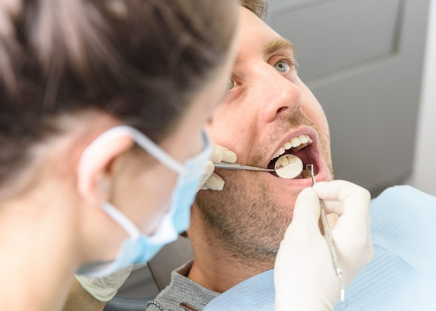 Dentist with a patient. Premium Photo