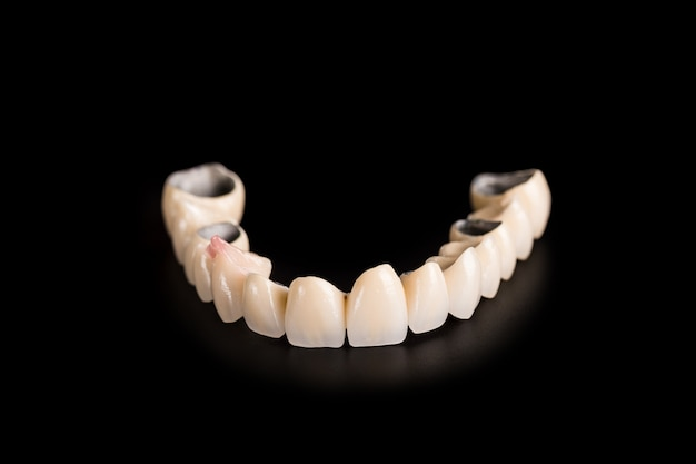 Denture on black background Premium Photo