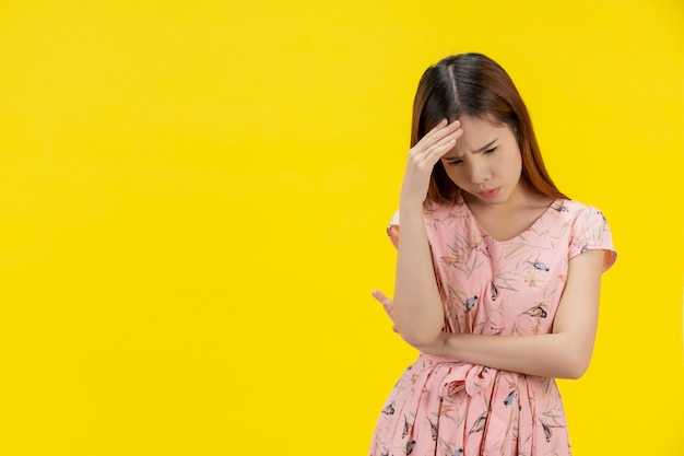 Depressed teen girl showing sadness and stress Free Photo