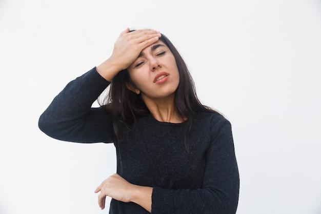 Depressed unhappy woman touching head Free Photo