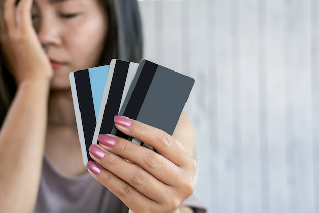 Depressed woman hand holding credit card Premium Photo