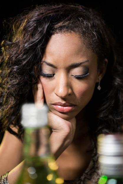 Depressed woman sitting at counter in bar Premium Photo