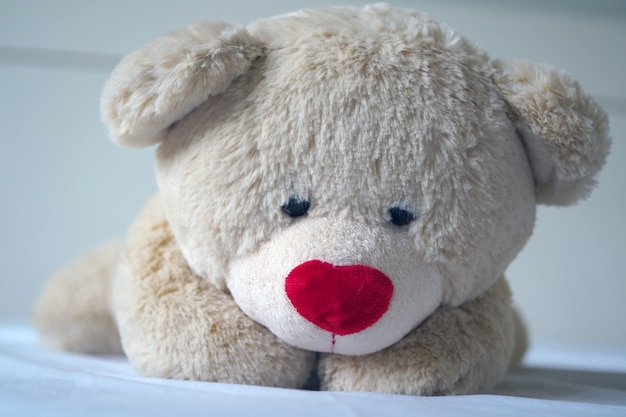 Depression concept grief of children, the teddy bear sleeps sadly in the bed, Premium Photo