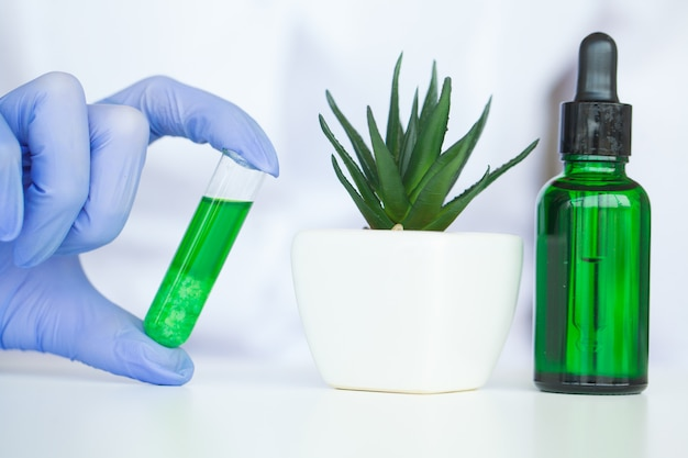 Dermatologist make the organic natural herb cosmetic product in the laboratory Premium Photo