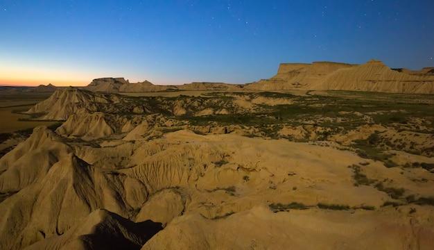 Desert landscape of navarra in   moonlit night Premium Photo