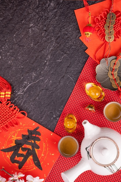 Design concept of chinese lunar january new year - festive accessories, red envelopes (ang pow, hong bao), top view, flat lay, overhead above. the word 'chun' means coming spring. Premium Photo