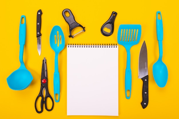Design concept of kitchen utensils isolated on yellow background Premium Photo