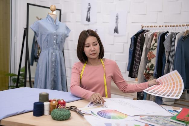 Designer concept. the dressmaker is designing an evening dress in the room Premium Photo