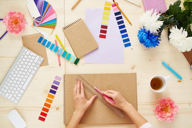 designer creative pattern hand paper Premium Photo