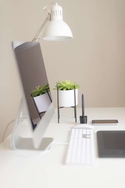 Designer workspace. minimalistic home office. blank screen desktop computer Premium Photo