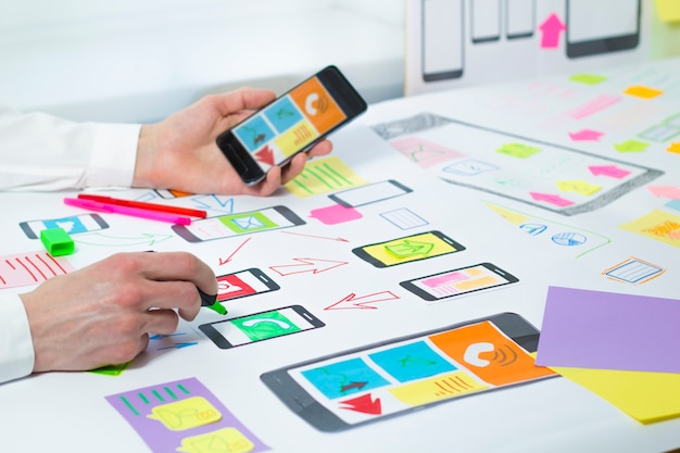 Designers develop and create a project of applications to mobile phones. Premium Photo