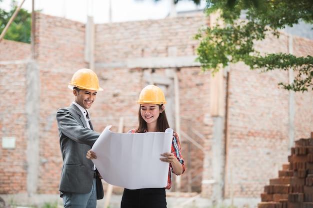 Designers discussing construction plan Premium Photo