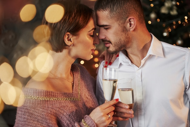Desire is in the air. nice couple celebrating new year indoors with classic beautiful clothes on they Premium Photo
