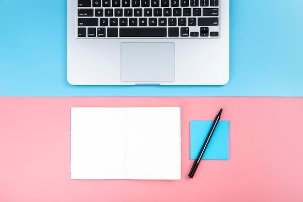 Desk arrangement with empty notepad Free Photo