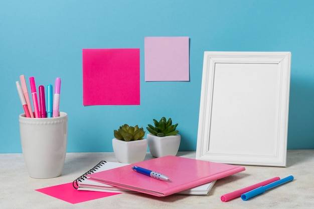 Desk arrangement with pink items Free Photo