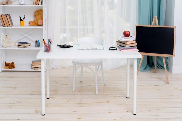 Desk in room of schoolkid Free Photo