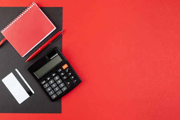 Desk stuff on red background with copy space Free Photo