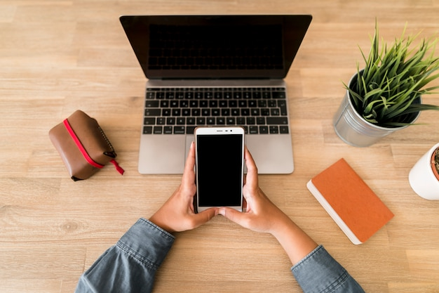 Desktop with laptop and mobile phone Free Photo