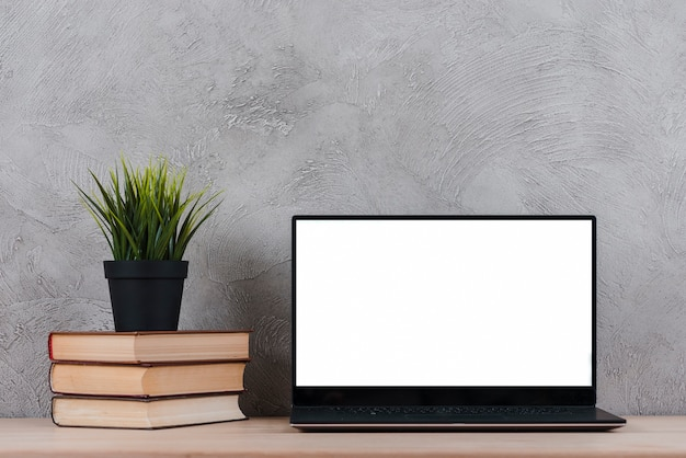 Desktop with laptop and office elements Free Photo