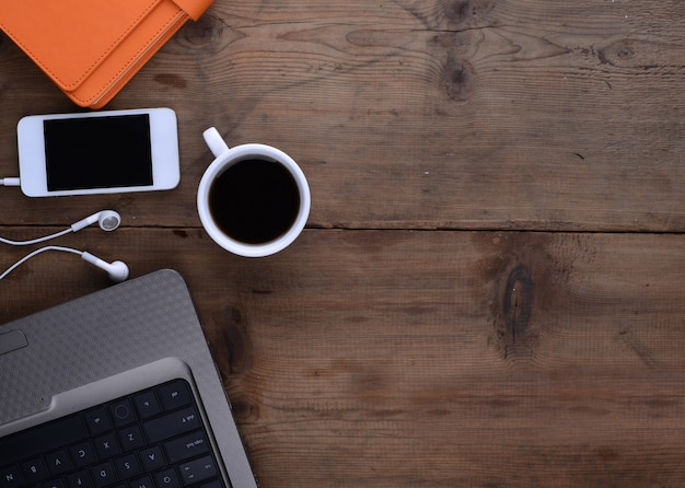 Desktop With Notebook Smartphone Coffee And Laptop Photo