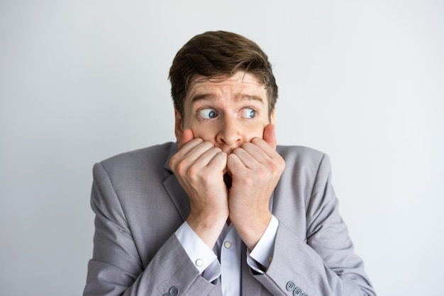 Desperate and scared businessman keeping silence Free Photo