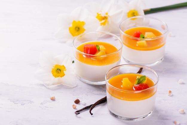 Dessert panna cotta with fresh berries on wooden background Premium Photo