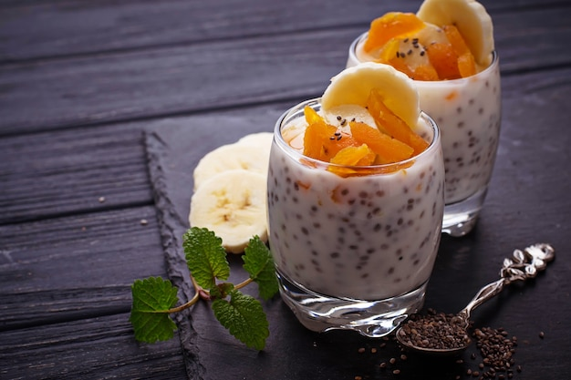 Dessert with chia seed, dried apricot and banana Premium Photo