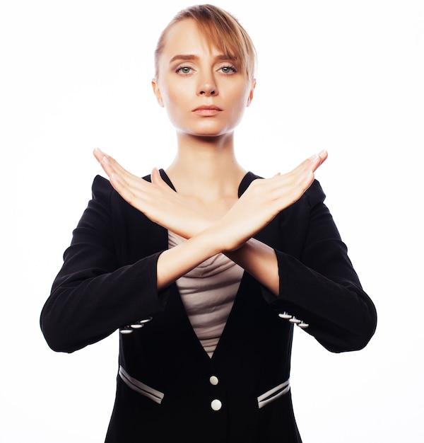 停止destureを作る若いビジネス女性 Premium写真