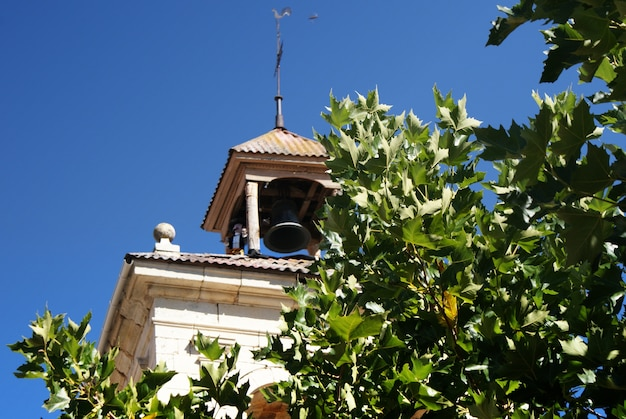 Detail of the bell tower of the church of boñar spain Premium Photo