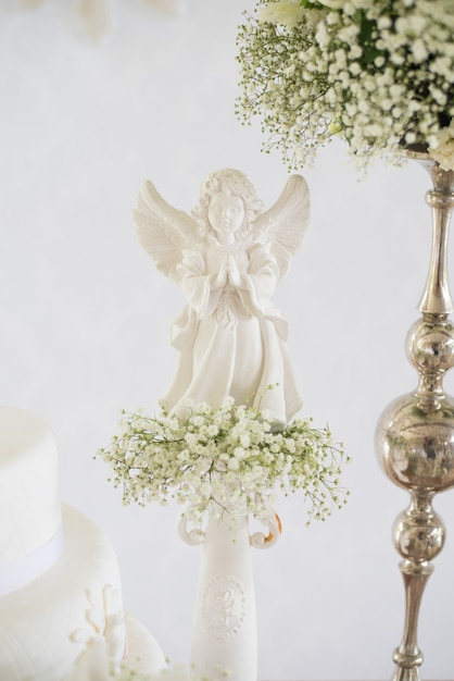 Detail of decoration, flowers and angelic - baptism Premium Photo