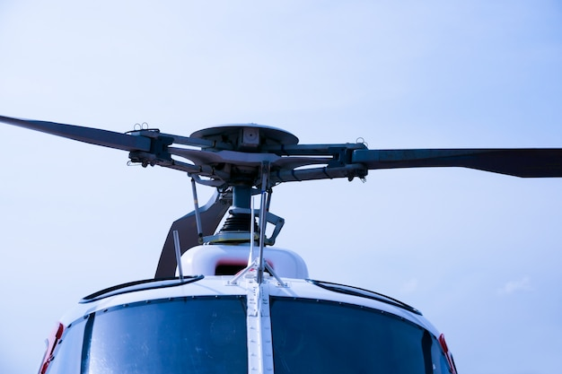 Detail of helicopter engineering on a beautiful blue sky Premium Photo
