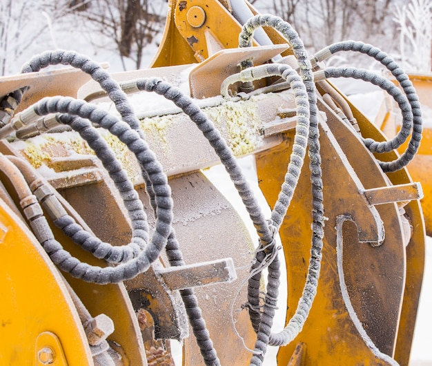 Detail of hoses with dirt and frost of an excavator Premium Photo
