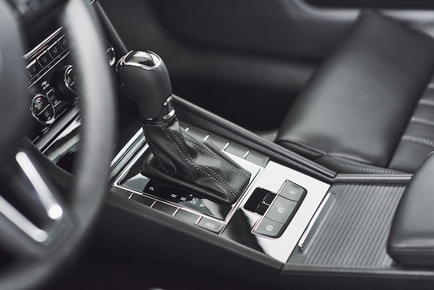 Detail of modern car interior, gear stick, automatic transmission in expensive car. Free Photo