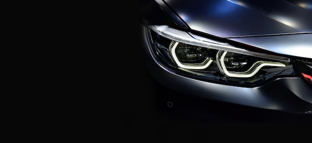 Detail on one of the led headlights modern car.copy space Premium Photo