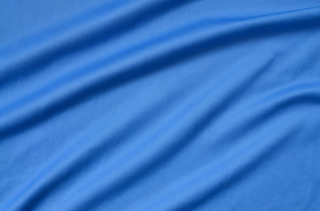 Detailed polyester blue fabric texture with many folds Premium Photo