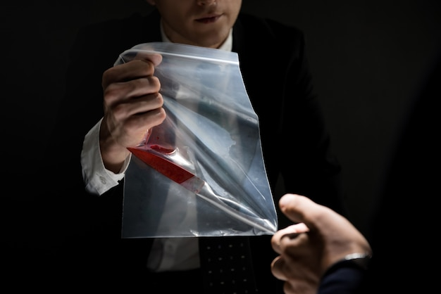 Detective showing an evidence in crime investigation Photo