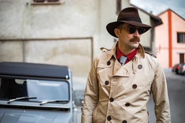 Detective walking in the city slums Premium Photo