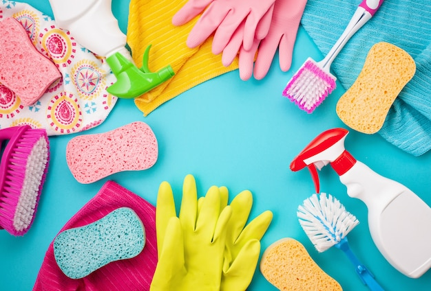 Detergents and cleaning accessories in pastel color. Premium Photo