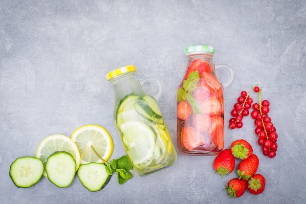 Detox fruit infused water, refreshing summer homemade cocktail Premium Photo