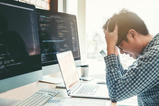 Developing programmer stressed out of work. development website design Premium Photo