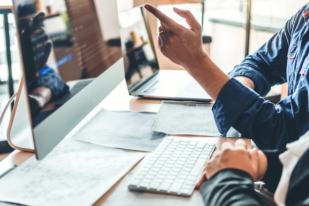 Developing programmer team development website design and coding technologies working in software company office Premium Photo