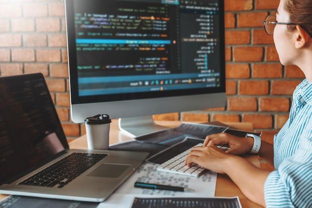 Developing programmer team reading computer codes development website design and coding technologies. Premium Photo