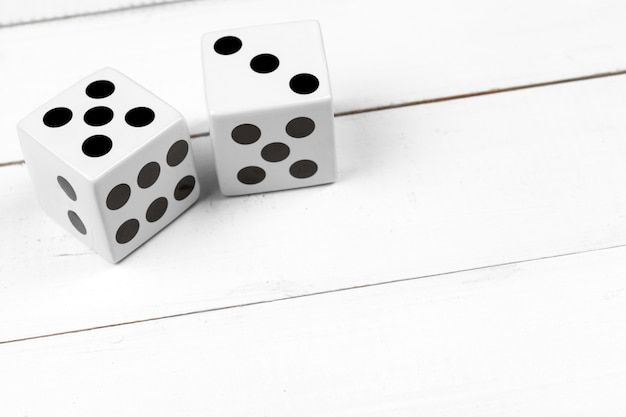 Dice against wooden floor Premium Photo