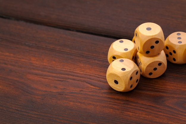 Dice on wooden table. background for casino games. Premium Photo